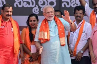 Prime Minister Narendra Modi with BJP workers at an election campaign rally, ahead of Karnataka polls, in Udupi on Tuesday. Photo: PTI
