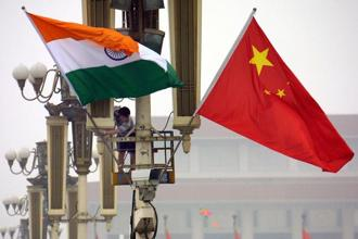 China and India—Asia's first and third largest economies, respectively—should aim for 'growth-friendly' fiscal consolidation to promote sustainable, inclusive growth. Photo: AFP