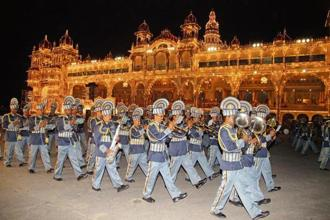 A file photo of the Royal Carnatic Orchestra band marching past the Mysore Palace. Photo: Courtesy Mysuru Police Band