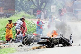 A two-wheeler is set on fire during panchayat polls in Nadia district of West Bengal on Monday. Violent incidents were reported from various parts of the state. Photo: PTI