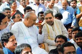 A file photo of H.D. Deve Gowda (left) and Siddaramaiah. They parted ways a decade ago over political differences. Photo: PTI