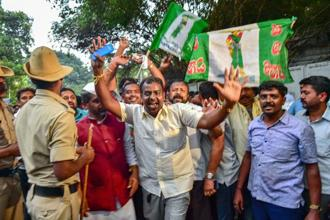 JD(S) party workers celebrate outside the Raj Bhavan after Congress party extended support to JD(S) to form the new government in Karnataka. Photo: PTI