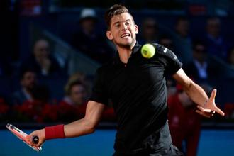 Austria's Dominic Thiem returns the ball to Germany's Alexander Zverev during their ATP Madrid Open final tennis match at the Caja Magica in Madrid on 13 May, 2018. The French Open starts on 27 May, while Wimbledon begins 2 July. Photo: AFP