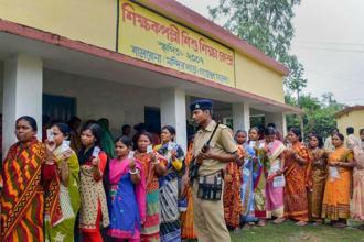 Voters standing in a queue to cast their vote during re-polling at Shikshak Pally booth, Gazole in Malda district of West Bengal on Wednesday. Photo: PTI