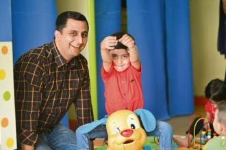 Nitin Arora with his son at IndiGo's on-site creche in its Gurugram office. Photo: Ramesh Pathania/Mint