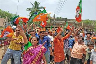 BJP supporters celebrate the victory of their party candidate in Panchayat elections, at Mallarpur in Birbhum district of West Bengal, on Thursday. Photo: PTI
