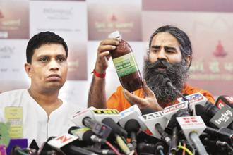 Patanjali Ayurved's management has blamed the sales slowdown chiefly on the after-effects of demonetisation and GST, but then most FMCG companies recovered from the twin policy setbacks in second half of FY18. Photo: HT