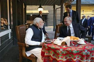 Russian President Vladimir Putin, right, and Indian Prime Minister Narendra Modi talk to each other while visiting the landmark cultural-ethnographic center 'My Russia' in the Krasnaya Polyana ski resort of Rosa Khutor in the Black Sea resort of Sochi, Russia, Monday. Photo: AP