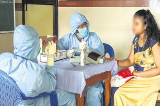Doctors wear safety masks at Kozhikode Medical College. Photo: PTI