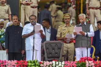 Governor Vajubhai Vala administers the oath to JD(S) leader H.D. Kumaraswamy as Karnataka chief minister. Kumaraswamy took office after the JD(S) and the Congress struck a post-poll alliance after 15 May's fractured verdict in Karnataka. Photo: PTI