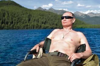 'It's hard to imagine any other Russian leader posing shirtless with a wriggling fish,' Albright says. Photo: Reuters