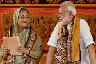 PM Narendra Modi speaks with his Bangladeshi counterpart Sheikh Hasina during the annual convocation of Visva Bharati University, in Birbhum, on Friday. Photo: PTI