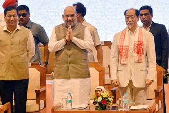 Nagaland chief minister Neiphiu Rio, right, with BJP president Amit Shah attends the 3rd conclave of North East Democratic Alliance (NEDA) meeting in Guwahati on 20th May. Photo: PTI