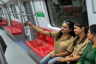 Metro officials take selfies during the media preview of the Magenta Line connecting Kalkaji Mandir to Janakpuri West on Thursday. With the opening of the new metro corridor, the total operational span of the DMRC network has reached to 277 km. Photo: PTI