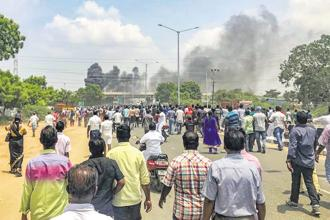 Smoke billows from burning vehicles during protests against the Sterlite copper plant in Thoothukudi, Tamil Nadu, on Tuesday, 22 May. Photo: PTI