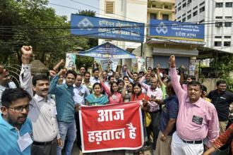Bank employees during a demonstration as part of their two-day strike to press for wage revision, in Patna on Wednesday. Photo: PTI