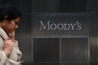A sign for Moody's rating agency is displayed at the company headquarters in New York.  Moody's said most sovereigns have embarked on tax administration and compliance reforms especially through the centralisation of multiple agencies. Photo: AFP