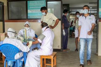 Doctors, patients wear safety masks as a precautionary measure after the 'Nipah' virus outbreak, at a Medical college, in Kozhikode. Photo: PTI