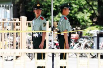 Paramilitary policemen take position near Beijing's Tiananmen Square on 4 June. Photo: Reuters