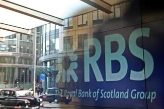 Shares of Edinburgh-based RBS fell 3.4% to 271.40 pence at 8.47 am in London trading. Photo: Bloomberg.