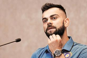 Virat Kohli's earnings of $24 million pales in comparison to boxer Floyd Mayweather Jr.'s $285 million. Photo: Reuters