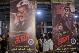 Neither rain nor the early morning chill could dent the spirit of Rajinikanth fans who came in large numbers to watch the superstar's latest Kaala first day first show. Photo: AP