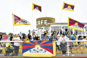 Fans wave Tibetan flags during the Conifa 2018 World Football Cup match between Abkhazia and Tibet. Photo: AFP