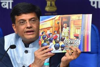 Railway minister Piyush Goyal shows a publication while speaking during a press conference on the achievements of the ministry in the last four years, in New Delhi on Monday. Photo: PTI