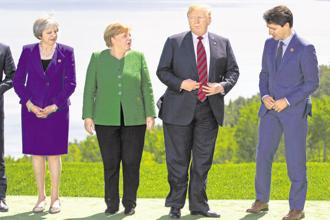 (From left) UK PM Theresa May, German chancellor Angela Merkel, US President Donald Trump, and Canadian PM Justin Trudeau during the G7 summit in Quebec on 8 June. Photo: Bloomberg