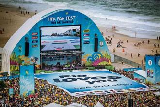 File photo of fans stretching a giant sign placed at the Fifa Fan Fest 2014 on the Copacabana beach in Rio de Janeiro. Photo: Reuters