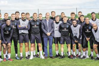 Britain's Prince William poses with the England football team as he visits them while they prepare for the 2018 FIFA World Cup, at Leeds on 7 June. Photo: Reuters