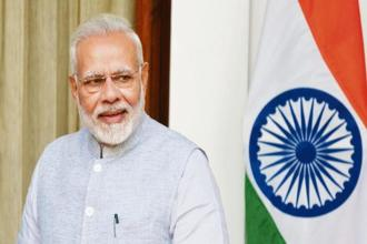 Prime Minister Narendra Modi on Friday interacted with the beneficiaries of Digital India programme across the country through video-conferencing. Photo: Mint