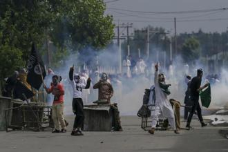 Kashmiri protesters clash with security forces during a protest after Eid prayers in Srinagar on Saturday. Photo: AP