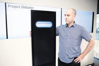 Noam Slonim, principal investigator, stands with the IBM Project Debater before the debate. Photo: AP