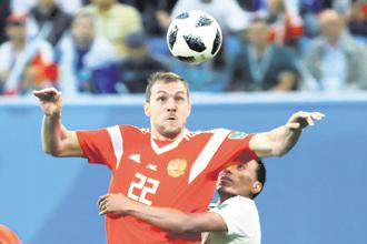 Russia's Artem Dzyuba in action during their match against Egypt on Tuesday. Photo: Reuters