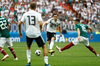 Germany's Mesut Ozil was at times left covering for Joshua Kimmich during their opening game against Mexico. Photo: Reuters