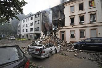 A car and a house are destroyed after an explosion in Wuppertal, Germany, on Sunday. Photo: AP