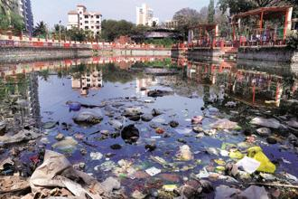 A file photo of discarded plastic bags, containers at Bhujale Lake in Malad west Mumbai. Photo: Mint