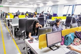 Co-working spaces are now being offered by several firms across India that can be rented out on an hourly, daily or monthly basis. Photo: Bloomberg