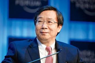 Yi Gang, governor of People's Bank of China. China has three obvious bubbles that are increasingly feeding one another: borrowing, credit and property. Photo: Bloomberg
