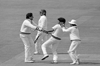 India captain Kapil Dev (left) and wicket keeper Kiran More congratulate Chetan Sharma after he dismissed Allan Lamb during the first Test at Lord's in 1986. Photo: Popperfoto