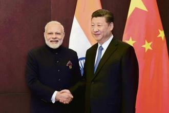 A file photo of PM Modi and Chinese President Xi Jinping. Ties between Indian and China could be key to stability in the new global order.  Photo: PTI