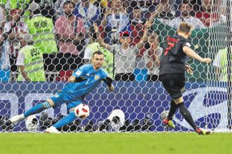 Croatia's midfielder Ivan Rakitic scores the decisive penalty in their quarter-final against Russia on Saturday. Photo: AFP