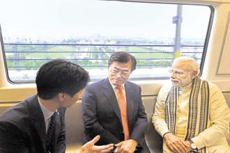 PM Narendra Modi with South Korean President Moon Jae-in take a ride on the Delhi Metro on Monday. Photo: PTI