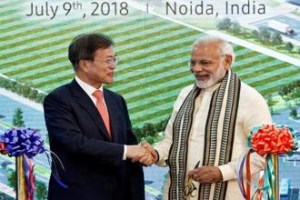 South Korean President Moon Jae-in and PM Narendra Modi shake hands after inaugurating the Samsung Electronics manufacturing facility in Noida. Photo: Reuters