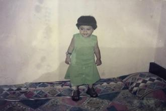 Imraz at two, wearing a new dress her father sent her from the Gulf.