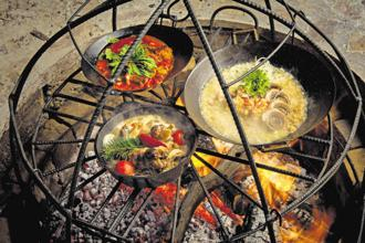 Pit cooking is a traditional technique used in various parts of the country. Photo: Alamy