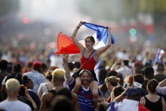 People celebrate on the Champs Elysees avenue after France won the World Cup 2018 final match between France and Croatia, in Paris on Sunday. Photo: AP