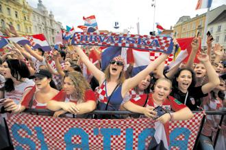 Croatians wait to welcome their football team on their arrival in Zagreb on Monday. Photo: AP