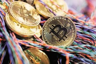 The worlds of finance and crypto have become increasingly intertwined after last year's Bitcoin boom. Photo: Bloomberg